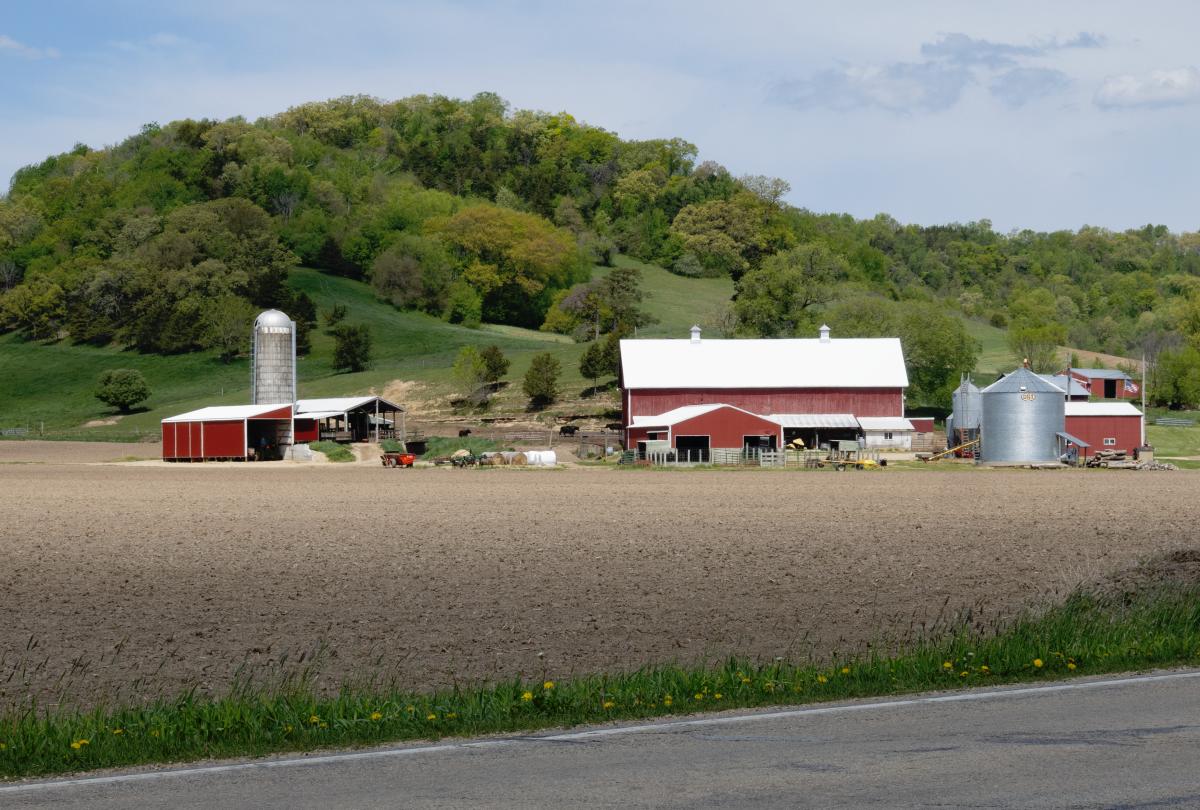 Farm in wooded landscape